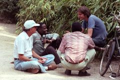 Billy Graham chats with young people in an Amsterdam park in 1983. Nearby, the first international conference for itinerant evangelists was being held at the RIA Center, where some 4,000 evangelists from 133 nations gathered for plenary sessions and workshops intended to equip and train them in Bible study and evangelism efforts.