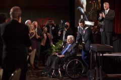 "Billy Graham, accompanied by his grandson Edward, enters his 95th birthday celebration on Nov. 7, 2013, after being introduced by his son Franklin. That same week, Billy Graham delivered a new message in a film called ""The Cross."" It aired on more than 480 television stations, and more than 26,000 churches participated in his ""My Hope America"" project."