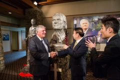 """CHARLOTTE, N.C., Sept. 28, 2018—Left to right: Franklin Graham, Chinese artist Yuan Xikun and the artist's sun, Henri Yuan Xikun,  react to the bust entitled, """"Billy Graham as Messenger,"""" one of two sculptures unveiled; the second is in the background to the left."""