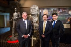 """CHARLOTTE, N.C., Sept. 28, 2018—Left to right: Franklin Graham, Chinese artist Yuan Xikun and the artist's sun, Henri Yuan Xikun,  posed for a photo with the bust entitled, """"Billy Graham as Messenger,"""" one of two sculptures unveiled. The second is in the background to the left."""