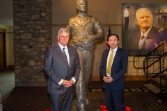 """CHARLOTTE, N.C., Sept. 28, 2018—Left to right: Franklin Graham and Chinese artist Yuan Xikun posed for a photo with the bust entitled """"Billy Graham as Sower,"""" one of two sculptures unveiled."""