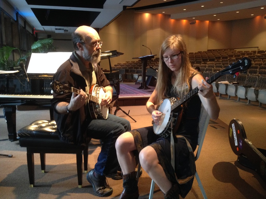 Michael Card giving banjo lessons to participant June 2014