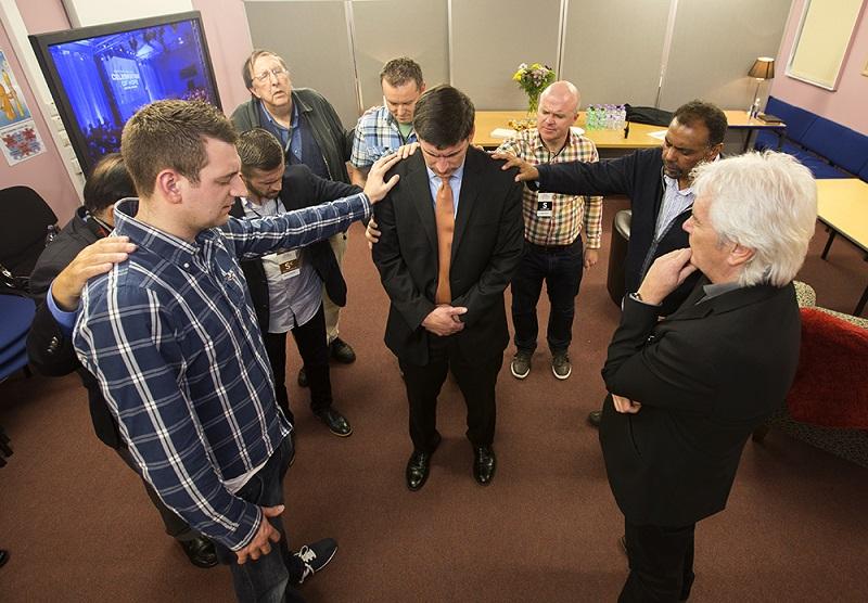 Wil Graham being prayed over in Scotland