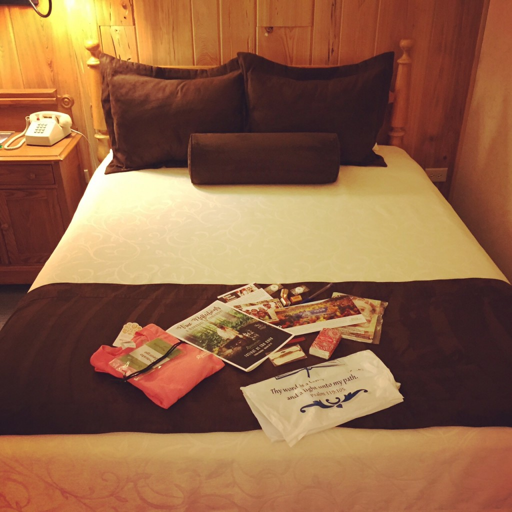 bed with goodie bag in inn room