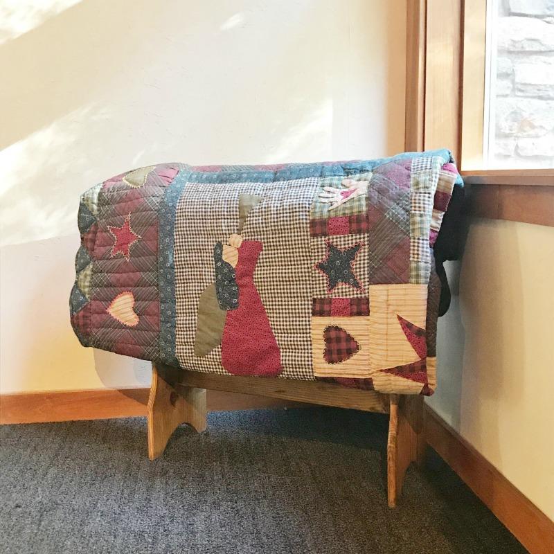 Blanket (cozy quilt draped in Pilgrims Inn common area)