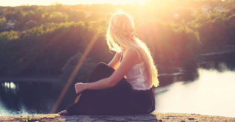 woman looking at sunset wondering do good people go to heaven