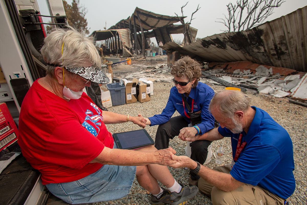 RRT chaplains praying with woman who lost her home in wildfires