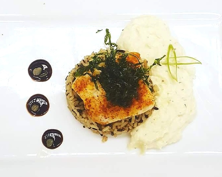 Grilled grouper served with whipped parsnips and wild rice pilaf. Photo credit: Chef Douglas Walls